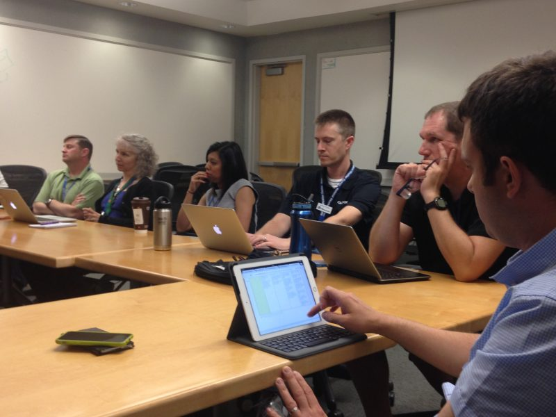 Mark Bevan from the UK Meteorological Office (foreground) participates with NWS forecasters, broadcasters, emergency managers and researchers in an event debrief during week 2 of the PHI prototype experiment.