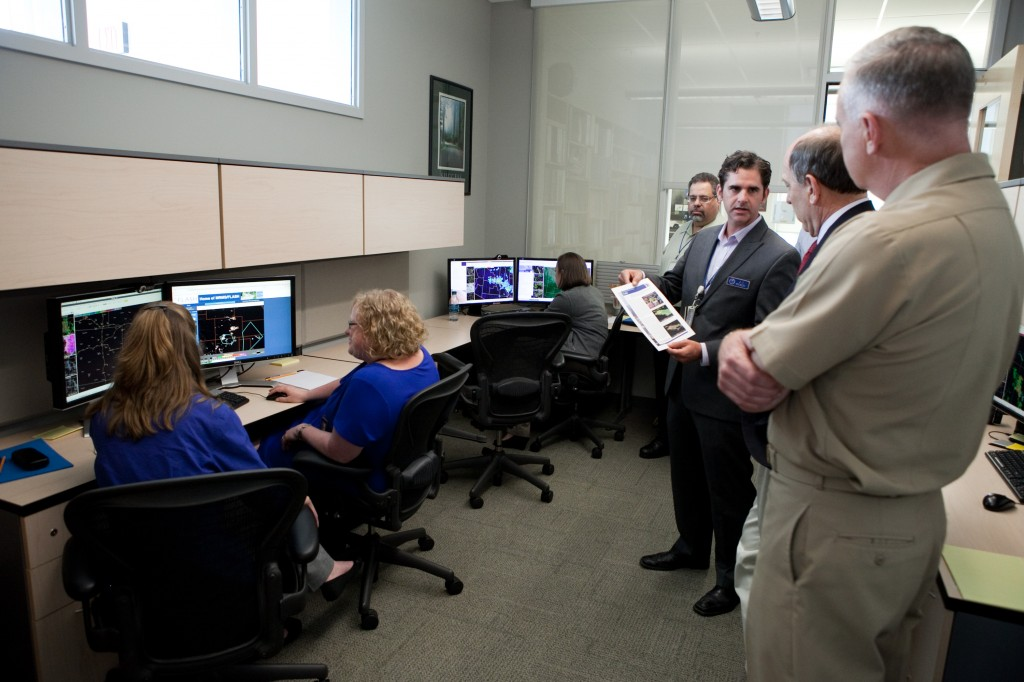 Dr. JJ Gourley explains the HWT-Hydro experiment to NWS Director Dr. Louis Uccellini and NOAA Deputy Under Secretary Vice Adm. Michael Devany