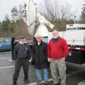 NSSL's Bob Staples (left) and Doug Forsyth (right) with an Environment Canada colleague in front of the NO-XP at Birch Lake, Washington.