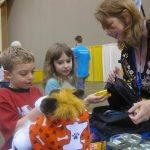 Kids learn what to put in an emergency backpack at WeatherFest 2012