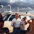 Dave Rust briefs his crew in front of a mobile lab.