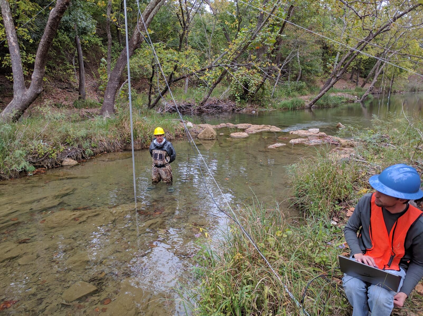 Researchers positioning stream radar above Honey Creek in Davis, Oklahoma. Credit: J.J. Gourley/ NOAA