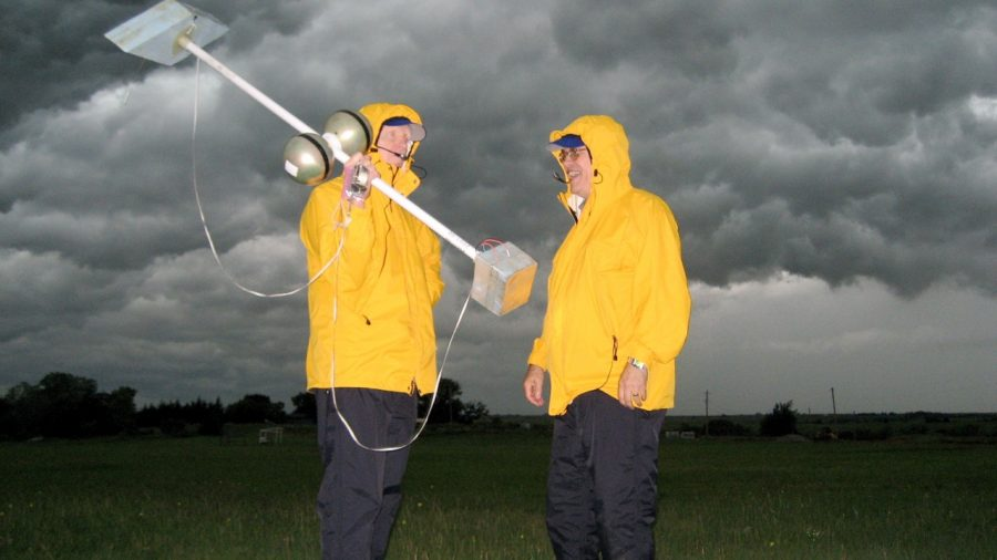 Dave Rust and Don MacGorman in a thunderstorm with weather tools.