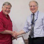 Dick Doviak receiving an award from NSSL Director Steve Koch.