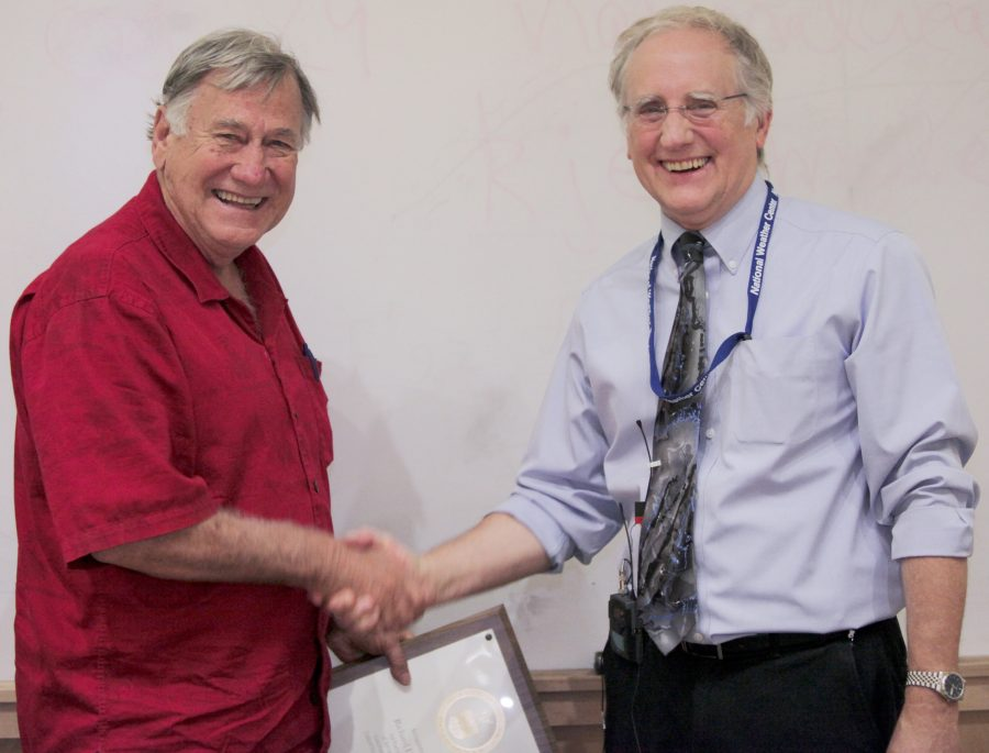 Dick Doviak receiving an award from NSSL Director Steve Koch.