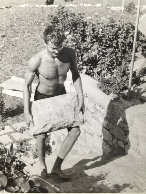 Dusan Zrnic carrying a rock in the mid-1950s.
