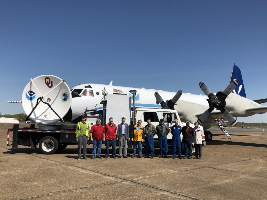 Researchers in front of a OU CIMMS mobile radar unit and the NOAAP-3 airplane used in VORTEX-Southeast.