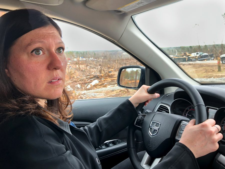 Kim Klockow-McClain in car viewing tornado damage