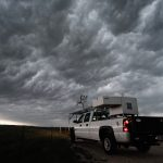 The LiDAR system pick-up truck in front of a storm.