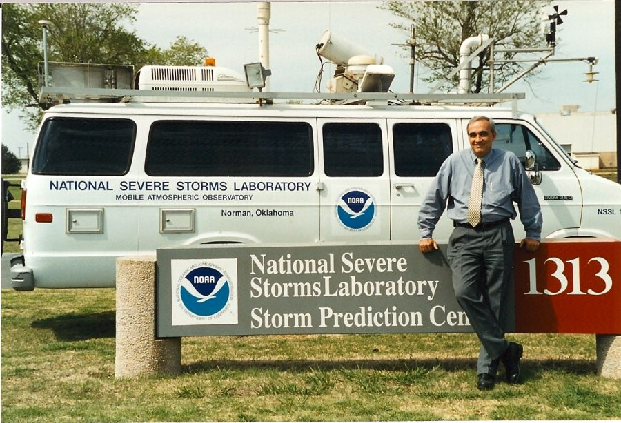 Former NOAA NSSL Director Jeff Kimpel in front of the former lab and research vehicle in Norman, Oklahoma.