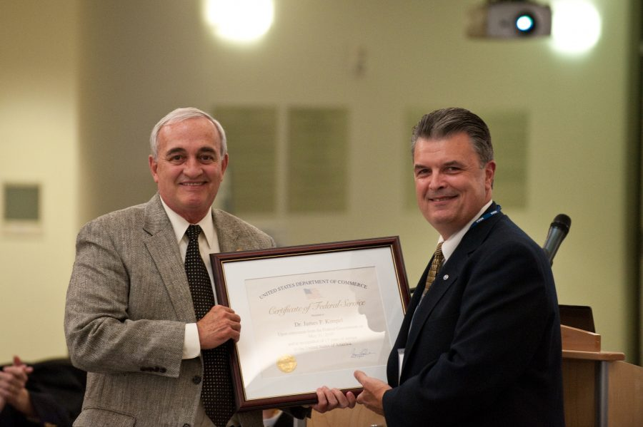 Former NOAA NSSL Director Jeff Kimpel receiving an award from NOAA Acting Chief Scientist Craig McLean at Kimpel's reitrement in 2010.