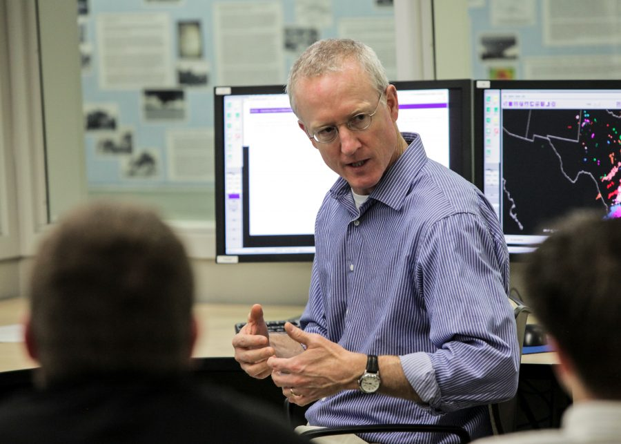 Jack Kain speaking to someone in the NOAA Hazardous Weather Testbed room