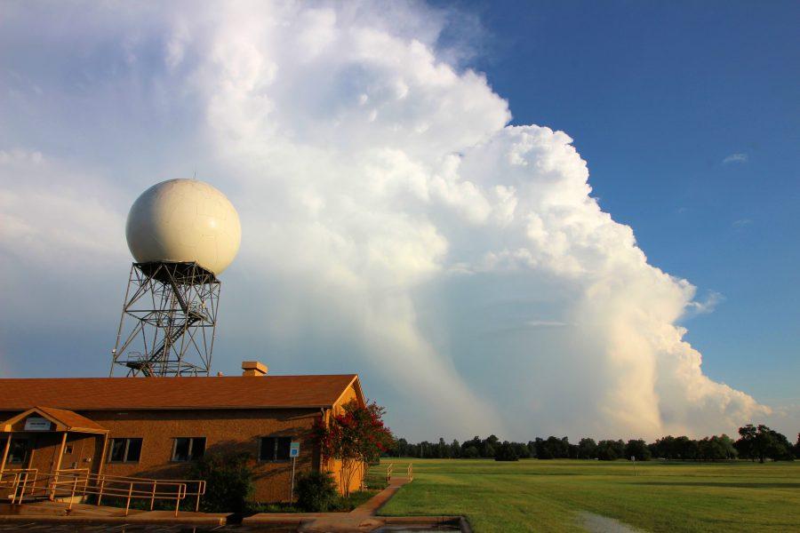 The KOUN radar with storm clouds behind it.