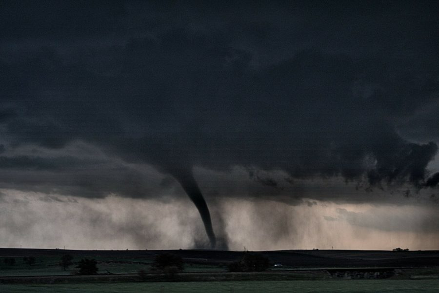 A tornado with debris on the ground.