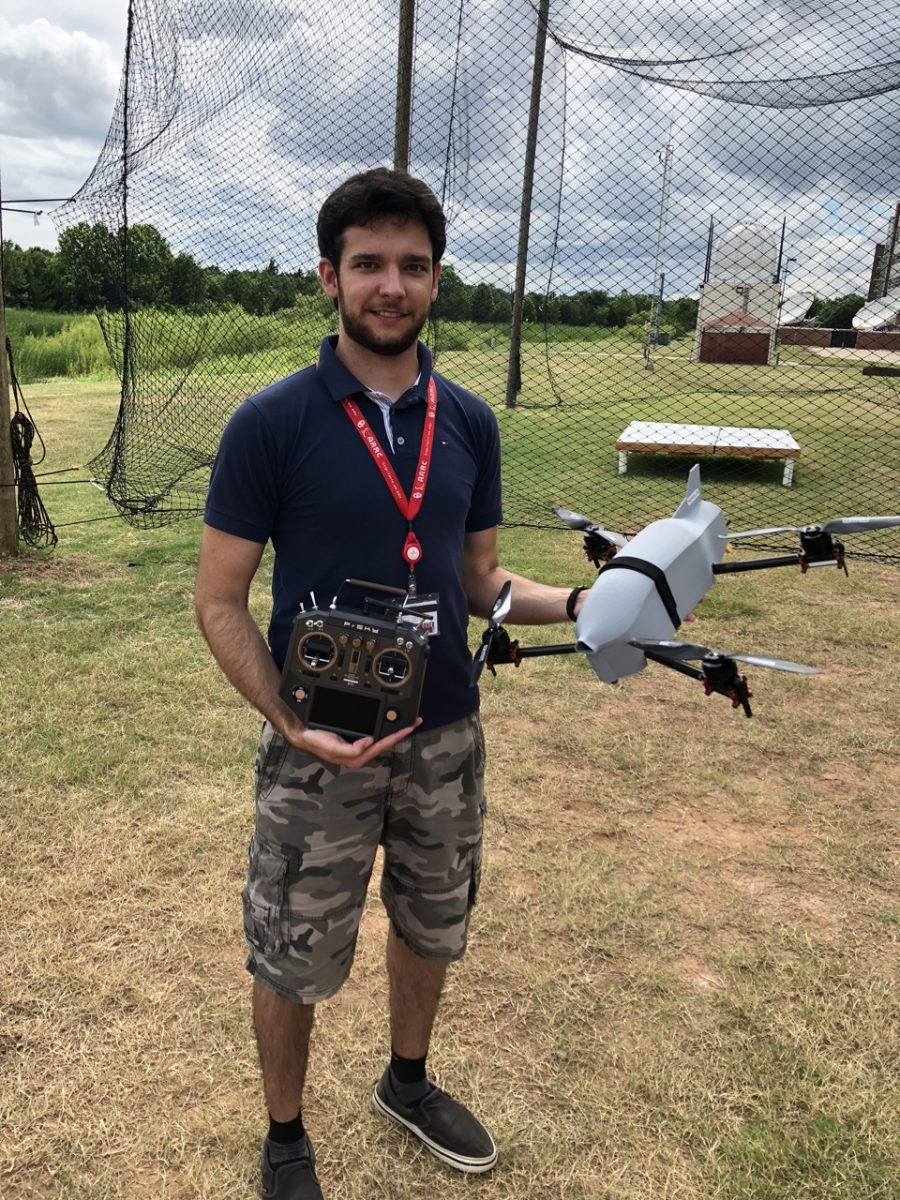 A person holding a UAS.