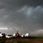 A fleet of VORTEX2 vehicles tracks a supercell thunderstorm near Dumas, Texas on May 18, 2010.  The blue-green color in the cloud is associated with large hail. Credit: UCAR