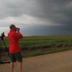 Nolan Atkins, Lyndon State University, documents their location through HD photographs and video.  We are near Cordell, OK. Credit: Susan Cobb