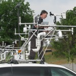 Sherman Frederickson, NSSL, works on the instrument racks on top of the probes, AKA mobile mesonets. Credit: Robin Tanamachi